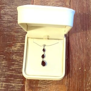 Sterling silver necklace with three black gems.